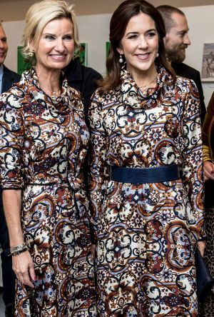 Princess Mary nails twinning moment with guest at fashion event