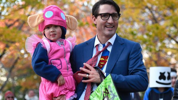 Justin Trudeau takes his  his youngest son Hadrien dressed as Paw Patrol character Skye trick-or-treating.