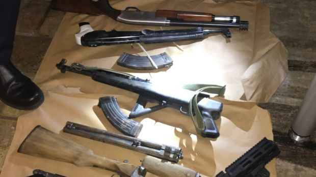 Police seized guns, ammunition and a hand grenade during raids targeting bikie gangs in Canberra.