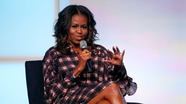 Former first lady Michelle Obama addresses the crowd during a conversation with poet Elizabeth Alexander at the second ...