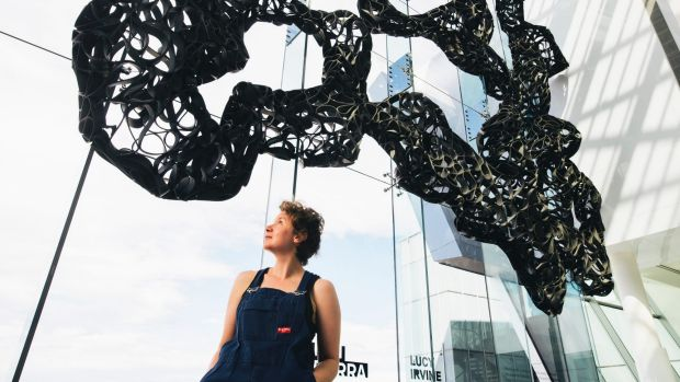 Lucy Irvine with her work, Surface Strategies, which has been installed at the Canberra Airport as part of the Design ...