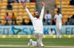 Strike weapon: Nathan Lyon appeals successfully for the wicket of India's captain Virt Kohli in Bangalore back in March.