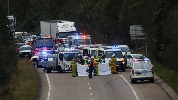 Emergency services at the scene of a fatal accident on the M1 Motorway at Cameron Park, between George Booth Drive and ...