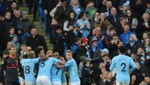 Manchester City players celebrate after Manchester City's Gabriel Jesus scored his side's third goal during the English ...