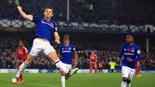 Everton's Leighton Baines celebrates scoring his side's third goal against Watford during the English Premier League ...