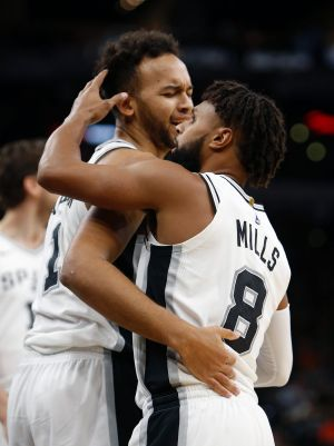 Strong showing: Patty Mills with teammate Kyle Anderson.