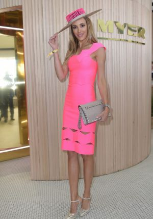 Bec Judd ushered in the arrival of celebrities in a bright pink Lolitta dress. Her hat was made by Danica Erard Millinery.