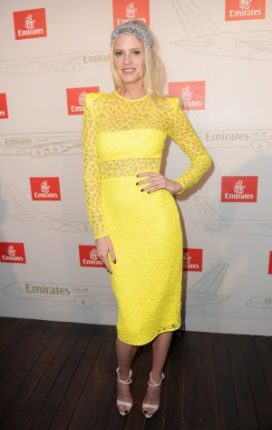 International model Lara Stone wears sunshine yellow on a rather gloomy day at the Emirates Marquee at the Birdcage ...