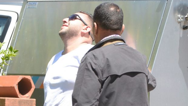 A distraught Khaled Arnaout, who was first on the scene, after discovering two boys had died.