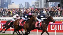 Rekindling ridden by jockey Corey Brown (centre) in action during their win in the 2017 Melbourne Cup at Flemington ...