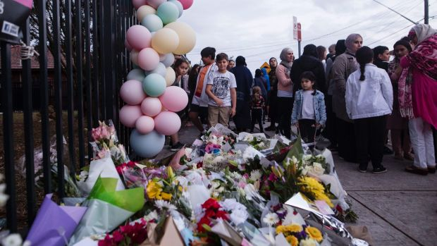 People gather for a vigil at Banksia Road Public School after the accident.