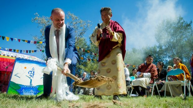 Chief Minister Andrew Barr and the spiritual leader Lama Choedak Rinpoche turn the first sod at the Stupa Temple of ...