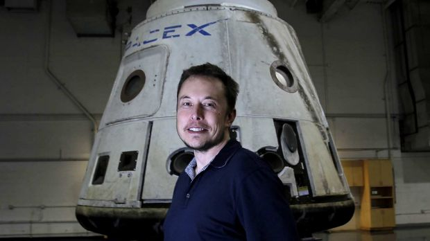 Tesla CEO Elon Musk with the SpaceX Dragon capsule.