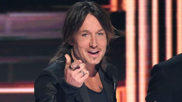 Keith Urban accepts his Single of the Year prize at the 51st CMA Awards in Nashville.