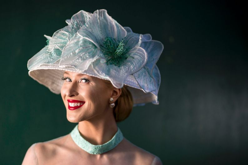 Hannah Ware wearing hat from Sandy Aslett Millinery and Milanna Inglis Fashion designer dress.