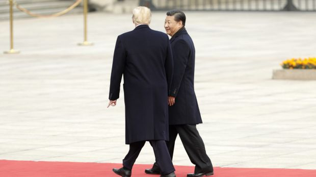 Donald Trump strolls with Xi Jinping during a welcome ceremony outside the Great Hall of the People in Beijing, China, ...