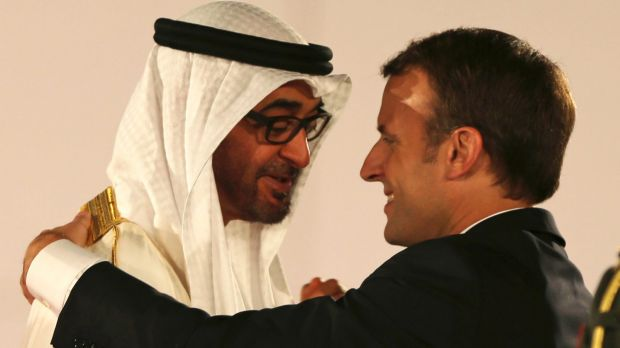 French President Emmanuel Macron is welcomed by the Crown Prince of Abu Dhabi Mohammed bin Zayed al-Nahayan to the ...
