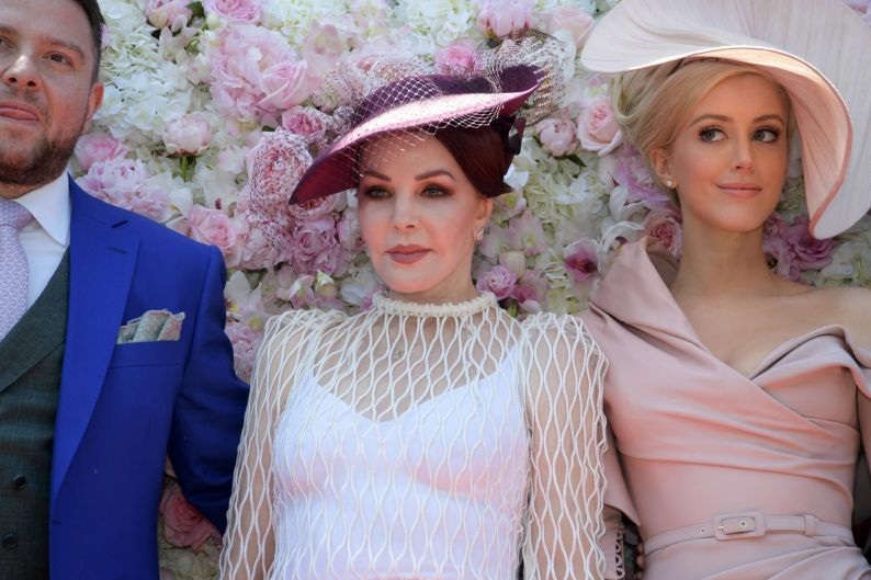 James Kennedy (left), Priscilla Presley and Jaimee Belle-Kennedy (right) arrive at the Kennedy Marquee in the Birdcage