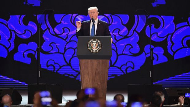 US President Donald Trump speaks on the final day of the APEC CEO Summit on the sidelines of the APEC Summit in Danang, ...