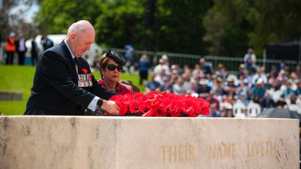 Governor-General Sir Peter Cosgrove lays a wreath on the Stone of Remembrance with his wife Lady Lynne Cosgrove.