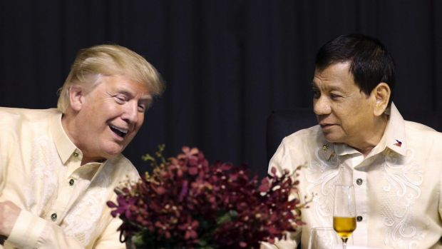 Donald Trump, left, talks with Philippine President Rodrigo Duterte during the gala dinner marking ASEAN's 50th anniversary. — Photograph: Associated Press.