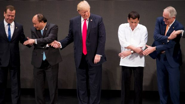 From left, Russian Prime Minister Dmitry Medvedev, Vietnamese President Tran Dai Quang, U.S. President Donald Trump, ...