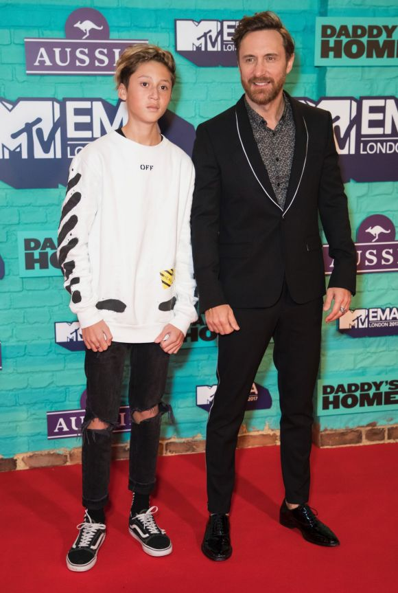 French DJ David Guetta, right, poses for photographers with his son Elvis upon arrival at the MTV European Music Awards 2017/