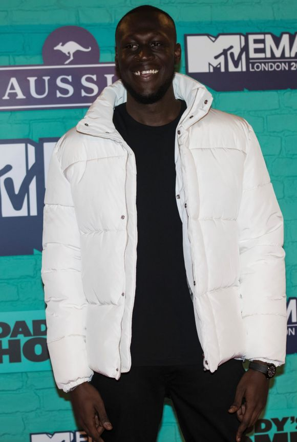 Stormzy poses for photographers upon arrival at the MTV European Music Awards 2017.