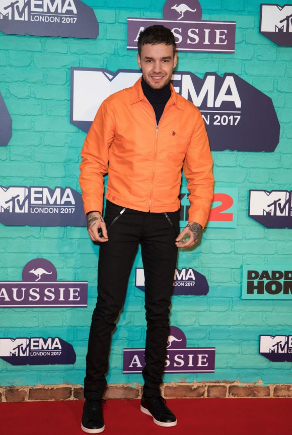 Former One Direction member Liam Payne poses for photographers upon arrival at the MTV European Music Awards 2017.