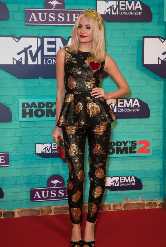 Singer Pixie Lott poses for photographers upon arrival at the MTV European Music Awards 2017 in London.