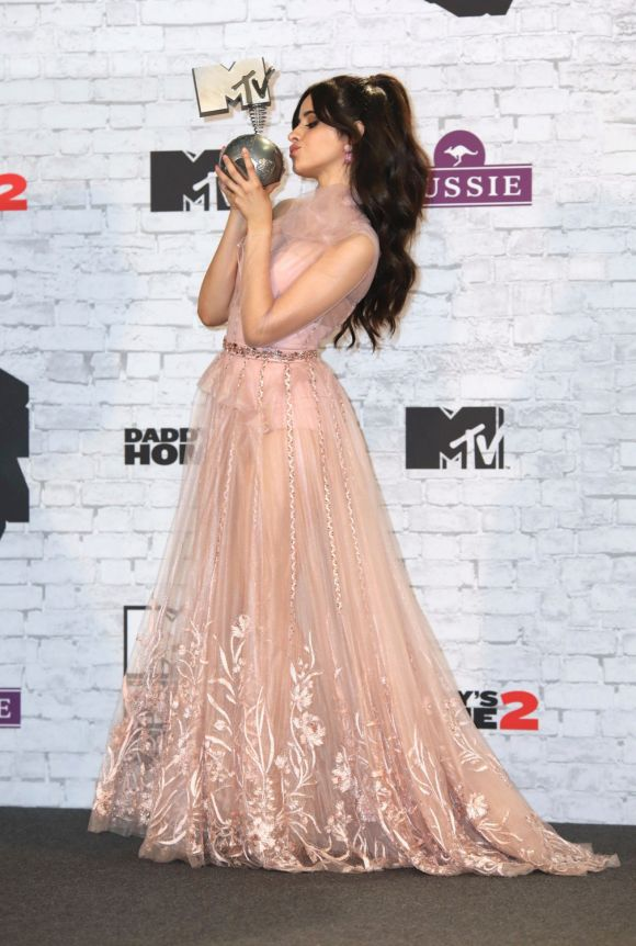 Singer Camila Cabello poses for photographers with her Best Pop award backstage at the MTV European Music Awards 2017.