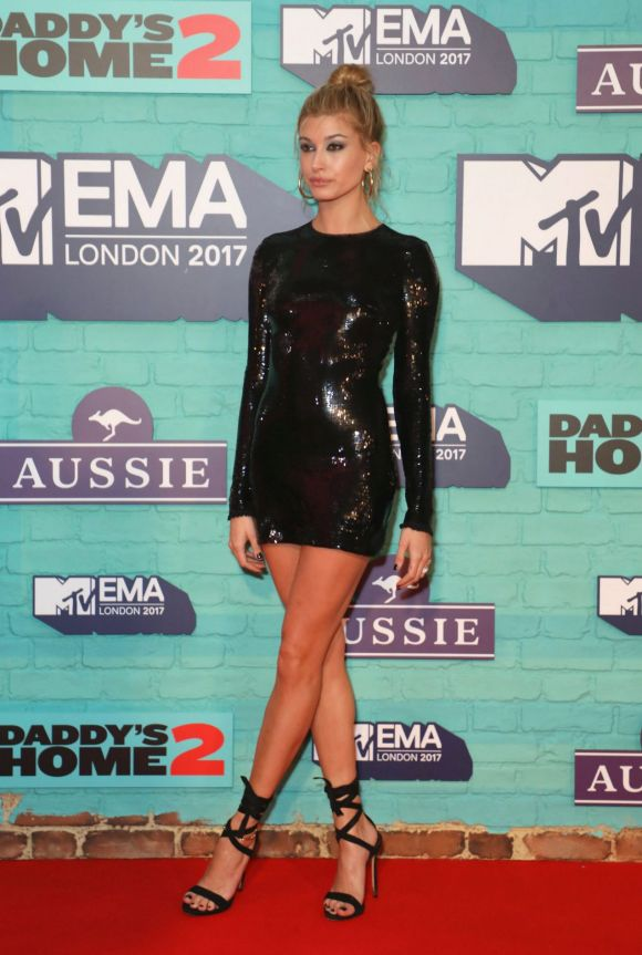 Model Hailey Baldwin poses for photographers upon arrival at the MTV European Music Awards 2017.