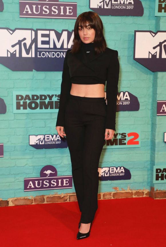 Singer Charli XCX poses for photographers upon arrival at the MTV European Music Awards 2017.
