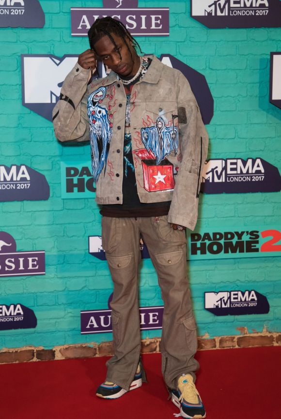 Travis Scott poses for photographers upon arrival at the MTV European Music Awards 2017.