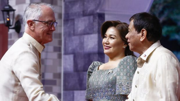 No word about atrocities. Prime Minister Malcolm Turnbull greeted by President of Philippines Rodrigo Duterte and ...