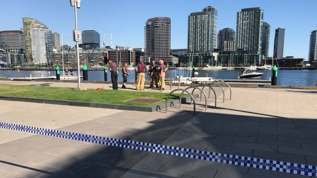 Emergency services at Docklands, where a body was found in the water on Monday afternoon.