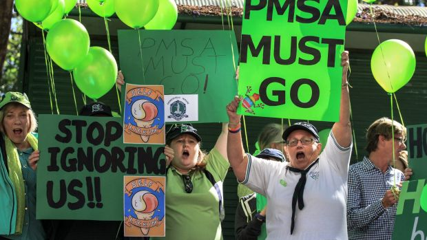 Parents don the green of elite Brisbane girls school Somerville House as they protest its governing body, the PMSA.