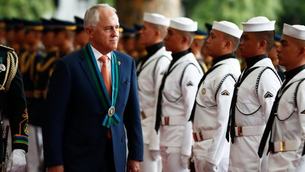 Malcolm Turnbull reviews the ceremonial guard in Manila during his welcome to Camp Aguinaldo to view a demonstration ...