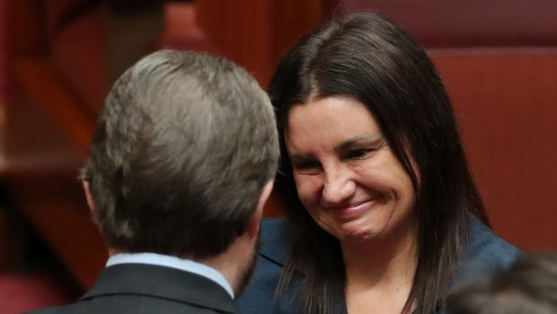 Jacqui Lambie is embraced by senator Derryn Hinch.