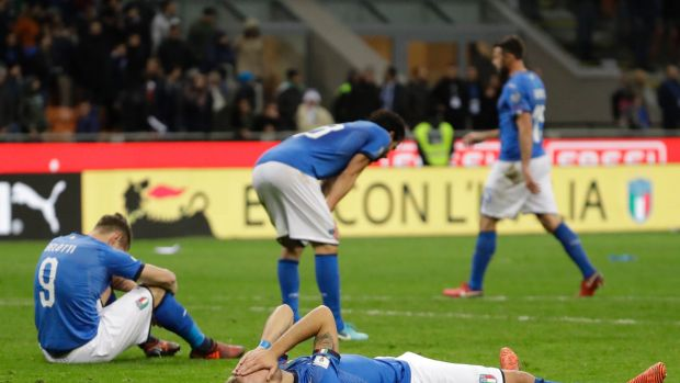 Devastating: Italian players after their elimination at the end of the World Cup qualifying play-off second leg soccer ...