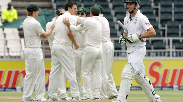 Dream debut: Cummins snares South Africa's AB de Villiers in 2011.