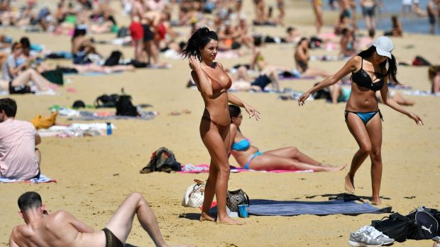 People enjoy hot weather at St Kilda beach in November this year.