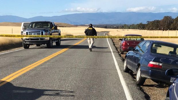 Crime tape blocks off Rancho Tehama Road leading into the Rancho Tehama subdivision south of Red Bluff, California.