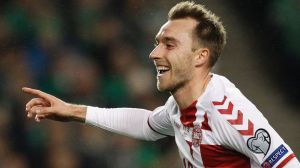 Denmark's Christian Eriksen celebrates after scoring his side's fourth goal against Ireland.