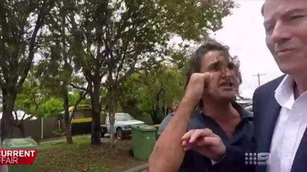 A Gold Coast man dubbed the 'neighbour from hell' attacked A Current Affair's Chris Allen.