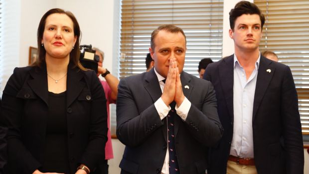 Revenue and Financial Services Minister Kelly O'Dwyer, Liberal MP Tim Wilson and his partner Ryan Bolger wait for the result.
