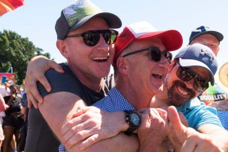 Crowds gather at Prince Alfred Park to watch the same-sex marriage result.