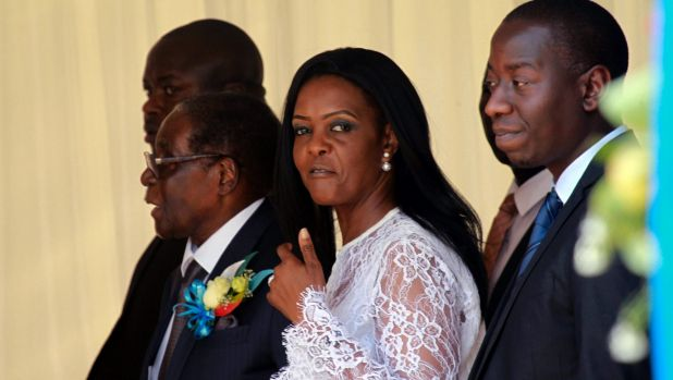 Zimbabwean First Lady Grace Mugabe, centre, and President Robert Mugabe at a ceremony to rename Harare's airport as ...