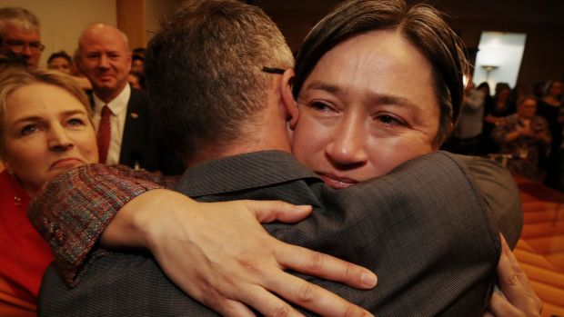 Senator Penny Wong hugs Senator Richard Di Natale after the result in the same sex marriage survey at Parliament House.