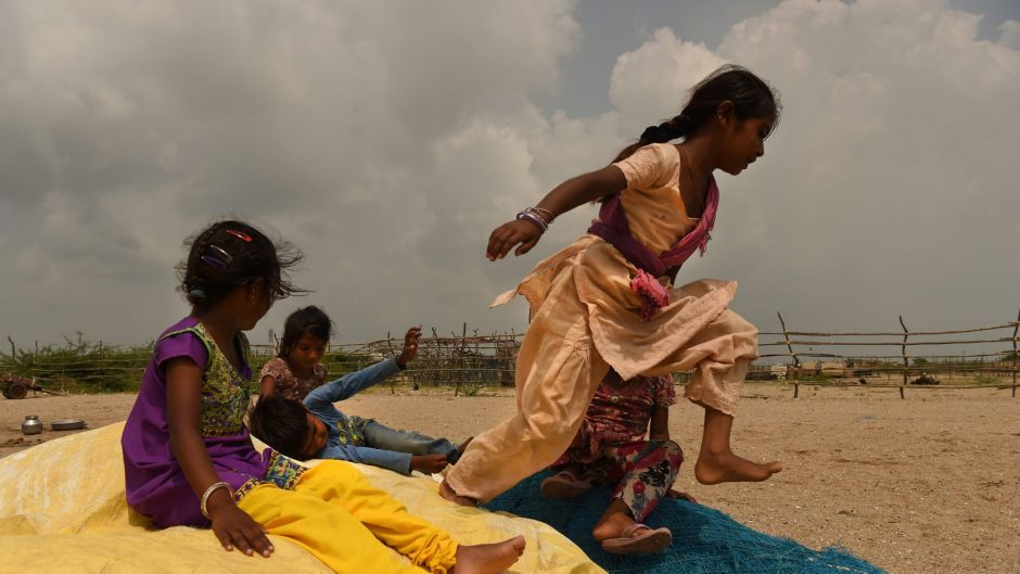 A group of children play in Tragadi Bandar, a fishing settlement on the Kutch coast, in western India. The settlement is ...